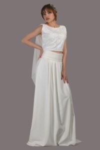 traje de novia con cuerpo de encaje y falda de pliegues